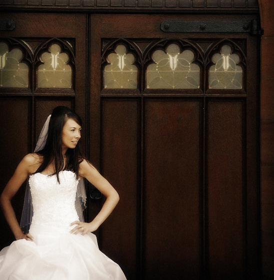 Bride on her wedding dress outside the Church.