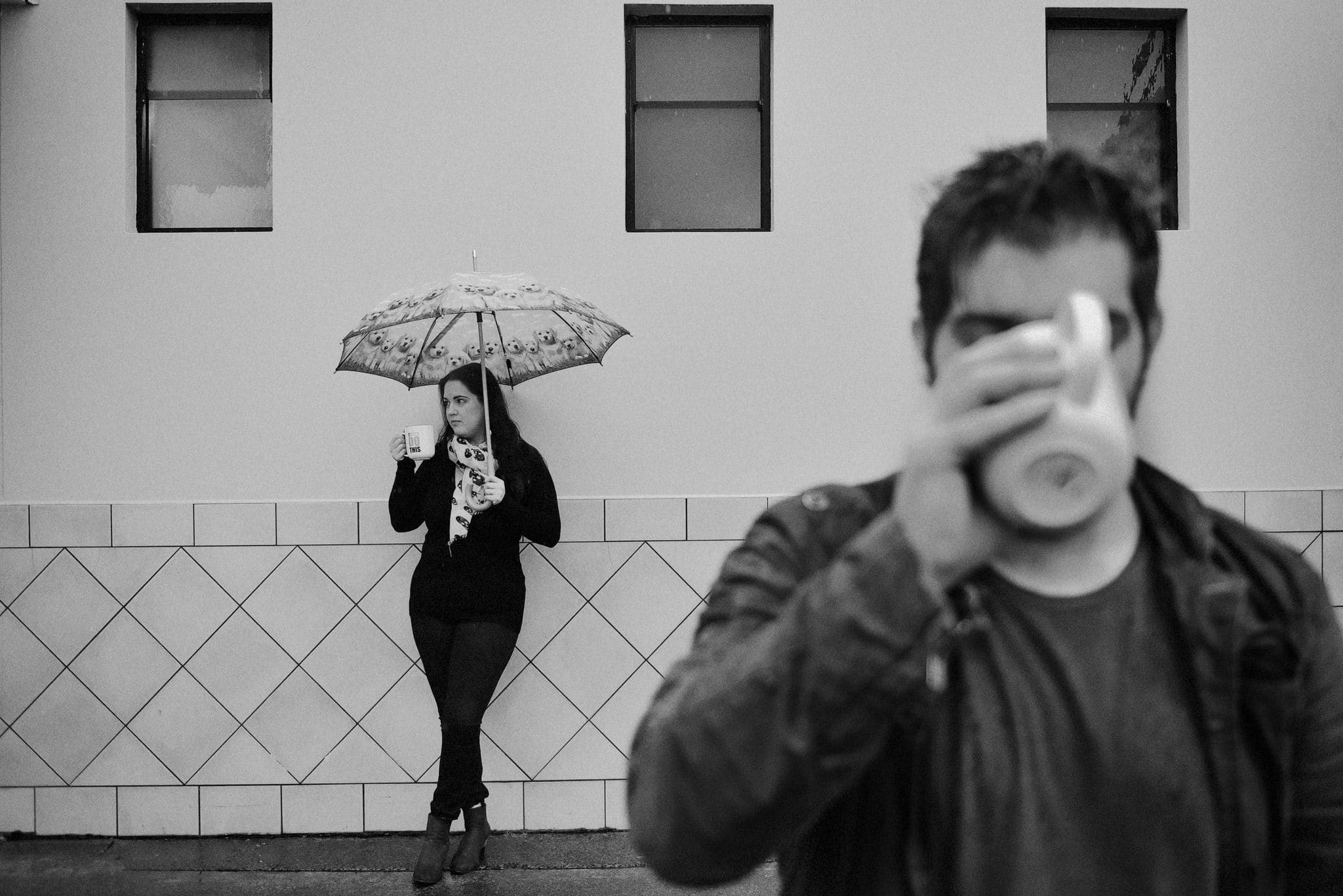 engaged couple standing in the rain